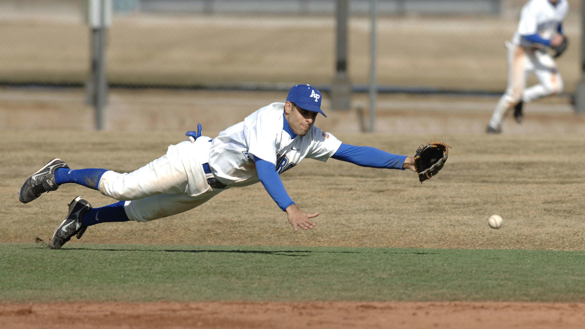 Baseball infielder laying out for a line drive